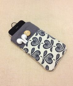 Cute hearts handmade fabric iPhone sleeve, iPod touch case, pouch, Kindle case, smart cellphone cover,Samsung galaxy cover. $15.99, via Etsy.