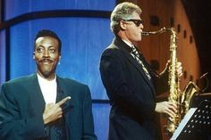 """June 3, 1992: The day after securing the Democratic Party's nomination for U.S. president, Bill Clinton makes an appearance on """"The Arsenio Hall Show,"""" where he plays the Elvis Presley hit """"Heartbreak Hotel"""" on the saxophone to a cheering audience. The appearance was later seen by historians as an important moment in Clinton's political career, helping build his popularity among minority and young voters."""