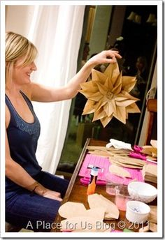 Brown Paper Flowers to hang on your christmas tree~ I like this, even made out of wrapping paper