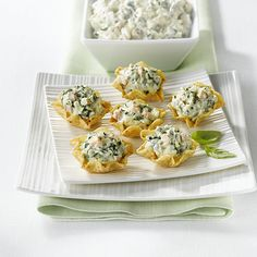 Veggie Delight Dip~ ½ c each: sour cream & cream cheese, 1 lg sweet onion, ¼ c mushrooms, 1 tsp fresh parsley, basil & cilantro, 4 oz fresh spinach, 1½ c feta cheese, ½ tsp S&P, 1 bag Baked! Tostitos®Scoops!® tortilla chips ~ Mix sour cream & cream cheese. Add onion, mushrooms, parsley, basil, cilantro, spinach S&P, feta. Stir gently. Place chips on plate & spoon mixture into each scoop. Serve.