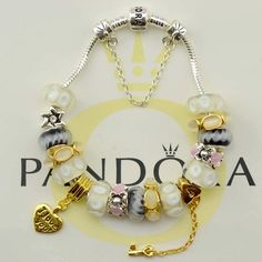 This is gives me so many ideas for my Pandora bracelet. I love the gold theme going on.
