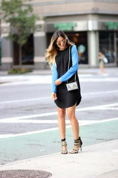 Long-sleeve mini dresses are a great item for evening! Here, Mel Rod from MelRod Style wears a sporty shift look with contrasting sleeves, giving a pretty pop of color! #fall #style