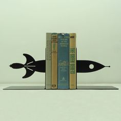 This set of bookends is handmade and designed by Knob Creek Metal Arts.    Made from solid steel, these bookends are heavy enough to hold up
