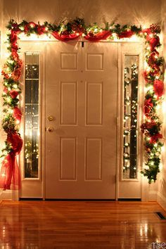 Don't forget to decorate the inside of your front door! Many people put garland around the outside, but why not add a bit of zest to the inside as well? Now you can remind people of the holiday spirit as they come and go! #xmas #decor Noel Christmas, Merry Little Christmas, Winter Christmas, Christmas Crafts, Outdoor Christmas, Homemade Christmas, Christmas Hallway, Christmas Living Room Decor, Office Christmas