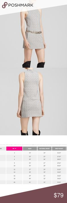 Free People Twiggy Shift Dress *Dress does not come with belt With a nod to mod Sixties style, this sleek little shift from Free People boasts a graphic chevron pattern and a thigh-high mini length that pairs perfectly with over-the-knee boots. Mock neck, sleeveless, side slit pockets Chevron stitch detail, pullover style Belt not included Polyester/cotton/spandex Free People Dresses Mini