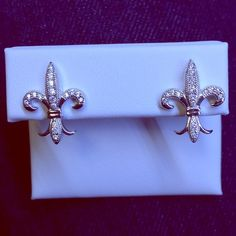 Lexi Nicole Fluer De Lis Silver Stud Earrings NWT NWT Lexi Nicole Brand earrings. New, never worn or tried on. Sterling silver setting, with simulated stones. Gorgeous earrings, Fluer De Lis are classic and elegant! Screw on backs, includes gift box *no trades* Lexi Nicole Jewelry Earrings