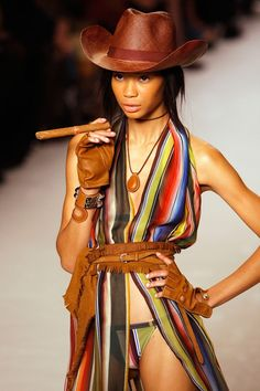 October 4 2008 Chanel Iman in a cowboy hat and posing with a cigar during the spring/summer 2009 show.  Photo By PA Photos
