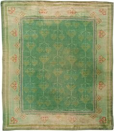 This circa-1910 antique Irish Donegal rug feaures an all-over design of repeating white heart abstractions containing floral motifs in subdued…