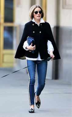 Who: Olivia Palermo What: Betsey Johnson cape; Paige jeans; Roger Vivier bag; Dior So Real Metal and Plastic Sunglasses ($505). Where: New York