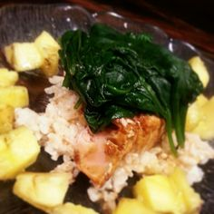 Grilled Salmon topped with Steamed Spinach and Grilled Pineapple over Brown Rice