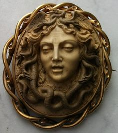"""Lava Medusa      Material: Lava, 15K gold tested .      Size:   2 5/8"""" by 2 1/8"""" only cameo is 2"""" by 1 5/8"""".      Date and Origin: Ca 1840, Italy, frame could be English."""