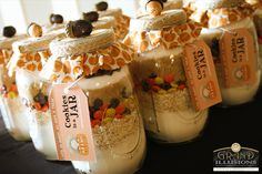 Cookie in a jar with custom tags.  What a unique gift for game winners.