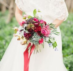 Burgundy winter bouquet with roses + orchids