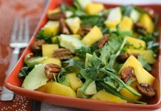 You don't need a lot of ingredients with this awesome combination of mango, avocado, pecans, & arugula. It's a pretty salad that brings cheer to cool-weather meals.
