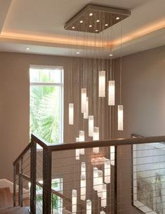Modern foyer chandelier designed specially for high ceiling spaces best as staircase lighting Stairwell Light Fixture, Stairwell Chandelier, Chandelier In Living Room, Living Room Lighting, High Ceiling Lighting, Stairway Lighting, Foyer Lighting, Ceiling Height, Contemporary Home Furniture