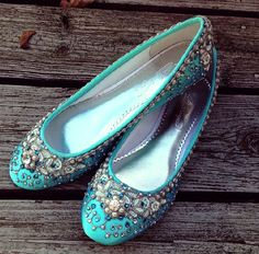 Stunning! These Robins Egg Blue satin flats have been covered in pearl trim and Swarovski crystal jewelry pieces and then hand painted with silver trim - they are a work of art. Do you have a special color youd like to include in the design? I can dye the shoes to match any color. See the last picture for color choices available. If you need a different color let me know and I can dye to match whatever color youre looking for! In order to ensure the best fit, please measure your foot by...