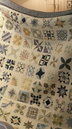 It's a foreign site so I'm not sure if you can find this particular quilt, but I love he colors (or lack thereof)!