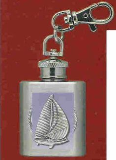 """Sailboat Stainless Steel Flask Key Chain by Heritage. $12.95. Sailboat Stainless Steel 1 oz Flask Key Chain with highly detailed emblem in fine pewter Buy Any Two Flask Key Chains & the price will be adjusted to the """"Two for Price"""" when the order is processed. This does not apply to Collegiate Emblem Items"""