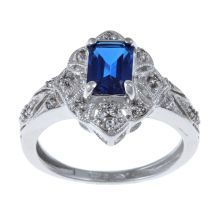 Sterling Essentials Sterling Silver Cubic Zirconia Ring. Crafted of sterling silver, this ring features a stylish vintage design complete with blue and white cubic zirconia. A highly polished finish completes the look of this ring.