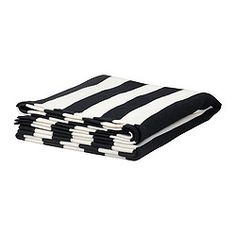 black and white striped throw to drape over the bed