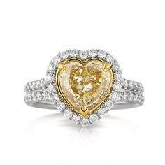 This fancy yellow heart shape diamond ring is one in a million! The spectacularly cut and perfectly shaped heart shape center diamond is EGL Certified at Fancy Yellow Heart Shaped Diamond Ring, Heart Shaped Engagement Rings, Colored Diamond Rings, Diamond Engagement Rings, Diamond Wedding Bands, Wedding Rings, Heart Jewelry, Heart Rings, Alternative Engagement Rings