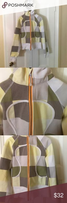 Lulu lemon yellow grey color block zip up hoodie 4 Lulu lemon yellow grey color block zip up hoodie 4 worn few times in good condition no damages or missing pieces. Really cute on lg logo front & on top of hoodie. Make an offer! lululemon athletica Jackets & Coats
