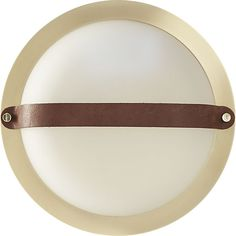 ship to shore.  Classic ship portholes shine anew in this modern maritime design by Mermelada Estudio.  Inspired by iconic ship windows, ours is made modern in brushed brass with a sophisticated leather strap.   A smart space-saver, sconce is perfect for flanking the bathroom mirror, illuminating a small entry or lined in the hallway.