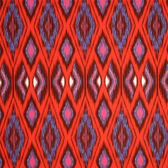"Red Blue Pink Ikat on White Stretch Twill Fabric - Beautiful colors of red, pink, and blue ikat ethnic style print on a white stretch twill fabric with spandex for good recovery and movement.  Stretch is about 30% across the grain and also has a natural bias stretch of about 25%.  Great for jeans, capris, shorts, jackets, pants, skirts, and more!   Medium ikat measures 4"".  ::  $9.50"