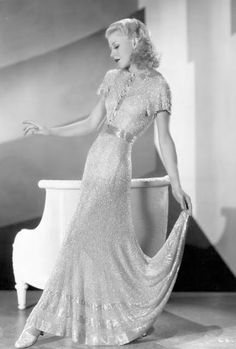 Ginger Rogers wearing a gown made of bugle beads sewn onto a turquoise chiffon