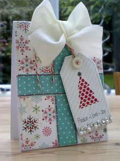 I really like this card, made to look like a wrapped gift/present with a gift tag attached. Add Some Sparkle...