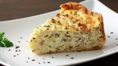 "A traditional treat from Southern Germany, this pie/quiche is packed full of caramelized onions, butter and bacon - that's a combination that always comes with a ""delicious guaranteed""!"