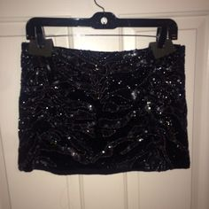 Parker Corsica Skirt Parker mini sequin black Corsica skirt. (Part of a set) the set is super cute together perfect for cocktail occasions or NYE. For more casual looks the sets can be worn separate with other items! This has been worn once and is in perfect condition. Comes with extra sequins! Parker Skirts Mini