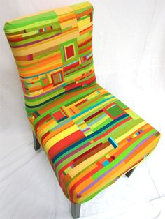 Jean Wells beautiful covered chair - I want one!  Tutorial: http://stitchinpostinsisters.typepad.com/stitchin_post_in_sisters/2012/02/pull-up-a-chair.html
