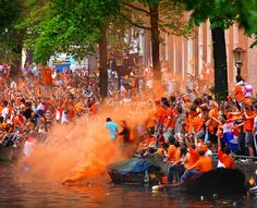 Channel boat parade that the city of Amsterdam organized for the Dutch (orange) soccer team for reaching the second place at the Fifa World Cup 2010