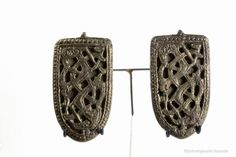 """""""Two tongue-shaped brooches decorated in the Jelling style."""" From Kornsá, Iceland ca. 900-1000 CE. Þjóðminjasafn Íslands."""