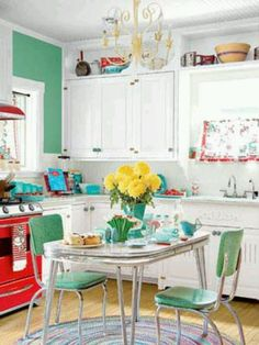 Neatest fifties kitchen! My mom had ivy vines over  lattice work wallpaper, though. We had an Indiana cabinet instead of wall cabinets, and a big wood table from the 1920s or early 30s, with six wood chairs. The overall effect was the same, though. Husband's family had the dinette set about like this one. Might try this look in my kitchen!