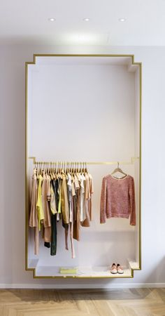 Gilded molding frames a box wardrobe — an elegant solution for open area clothing storage/display | Architectural concept by Elements for Maje boutique