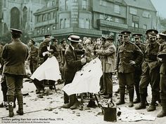 The Bridewell Museum | Norwich | Soldiers getting their hair cut in the Market Place, Norwich 1914 | Love this photo and adding a colour to the background helped the soldiers stand out more - this is in the 'Living in Norwich 1900-1950' gallery.