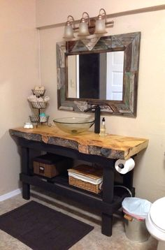DIY 2x4 vanity with a live edge plank counter top. Most amazing rustic bathroom that I've seen.