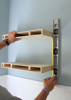 Measuring for placement of a second floating shelf in a DIY floating shelves project
