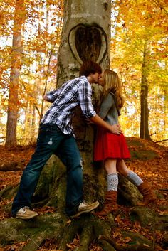 A heart carved in a tree with initials and date of wedding to be would be cute idea for save the date invite.