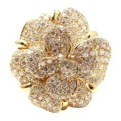 Chanel Diamond Yellow Gold Large Camellia Flower Ring | From a unique collection of vintage cocktail rings at https://www.1stdibs.com/jewelry/rings/cocktail-rings/