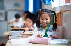 2014 - Johannes Eisele - Chinese children attend a class at the Jinqao Center Primary School in Shanghai on September 1, 2014.