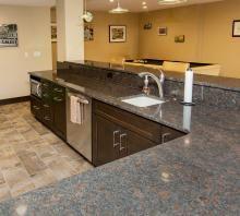 Dark Wood Cabinets And Light Granite