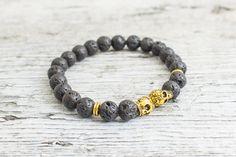 Black lava stone beaded gold Skulls stretchy bracelet, made to order yoga bracelet, mens bracelet, womens #bracelet