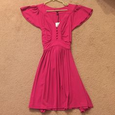 NWT Betsey Johnson Dress Old fashioned style and never worn! A beautiful fuchsia color. 96% rayon 4% spandex. Made in the USA, so it is old Betsey! Now her clothing is made in countries such as China. About 27in in length. Model is 5'4 with a 36DD chest. Has a for in the back to give the look of a smaller waist. So cute and old fashioned! NO TRADES. PLEASE CONSIDER THIS IS BRAND NEW, NEVER WORN TAGS STILL ON IF YOU STILL FIND THE NEED TO MAKE AN OFFER :) Betsey Johnson Dresses Midi