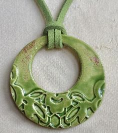 Green handcrafted ceramic pendant necklace ornate green suede