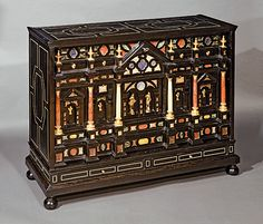 Cabinet. Venetian Workshop. With marbles, hard stones, gilded bronze. Inlaid with ebony and fillets of ivory on a wooden stand. 70 x 88,5 x 33,5 cm. End of the sixteenth, beginning of the seventeenth century. -WALTER PADOVANI. MILAN-
