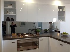 Fulham Road South unit - Kitchen finishes should be similar to this - ie white, glossy and the similar kitchen bench top. Probably go with a black/dark bench top instead.