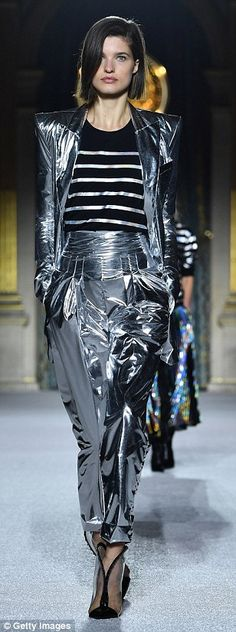 Over the moon: Space-age inspired outfits were also evident in the collection, with models...